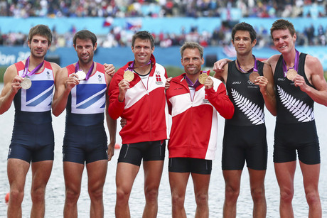 New Zealand bronze medalists in the Lightweight Men's Double Sculls Storm Uru (2-R) and Peter Taylor (R), Great Britain silver medalists Zac Purchase (L) and Mark Hunter (2-L) Denmark Gold medalists Mads Rasmussen (C-L) and Rasmus Quist (C-R) (Photo: AAP)
