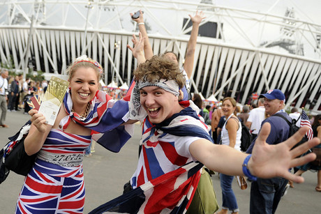 Spectators with the Union Jack flags pose in the Olympic Park (Photo: AAP)