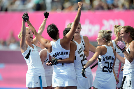 New Zealand players celebrate a draw against Germany and making it to the semi finals (Photosport)