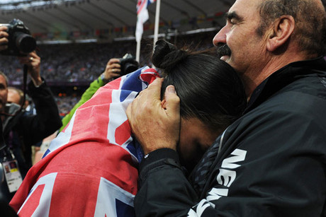 Valerie Adams is consoled by her coach Jean-Pierre Egger after her silver medal throw in the Women's Shot Put (Reuters)