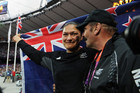 Valerie Adams is consoled by her coach Jean-Pierre Egger after her silver medal throw in the Women's Shot Put (Photosport)