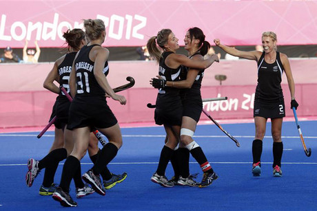 New Zealand's Gemma Flynn celebrates a goal with teammates during their women's Group B hockey match against the U.S. at the London 2012 Olympic Games at the Riverbank Arena in the Olympic Park (Reuters)