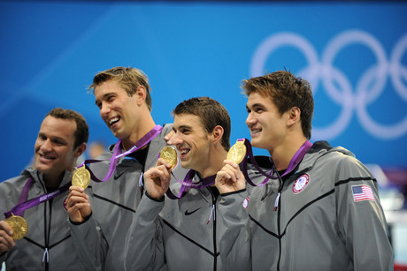 The USA's Michael Phelps (2nd from right) holds his gold medal with his team mates after winning the men's 4x100m medley relay final, Phelps' last Olympic event (AAP)