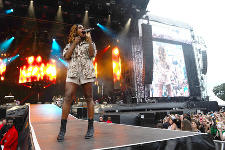 Alexandra Burke performs at Hyde Park in London as part of a series of free concerts to celebrate the Olympics (Photo: AAP)
