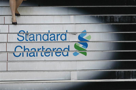 A woman walks down the stairs of the Standard Chartered headquarters in Hong Kong (Reuters)