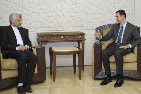 Bashar Assad (R) met with Iran's Security Chief yesterday to discuss military measures  (Reuters)