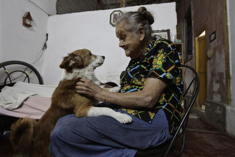 A Cuban senior citizen in her Havana apartment  (Reuters)