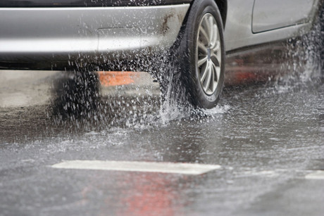 Surface flooding has already closed roads (file)
