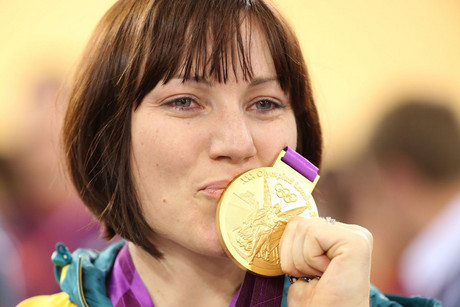 Australia's Anna Meares holds up her gold medal after the track cycling women's sprint finals (Reuters)