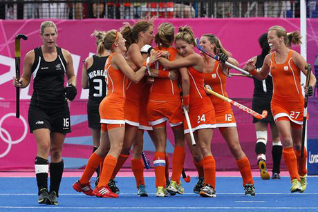 The Dutch side celebrates a goal against the women's Black Sticks (Reuters)