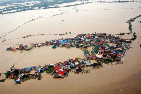 Houses swamped by floodwaters in Bulacan province, north of Manila (Reuters)