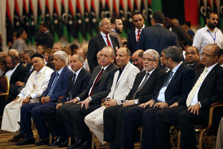 Members of the transitional council attend a press conference in Tripoli last month  (Reuters)
