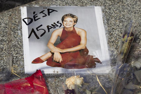 Admirers from around the world are paying tribute to Princess Diana at the Paris tunnel where she was killed  (Reuters)