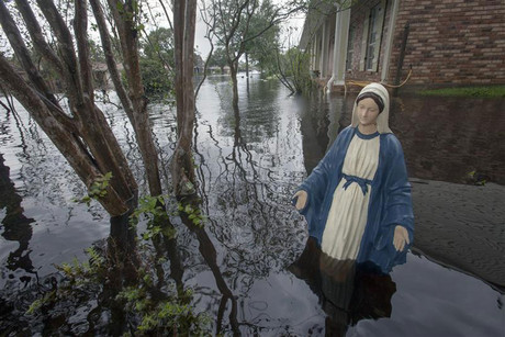 Statue of Virgin Mary stands in yard of house flooded by Hurricane Isaac in La Place (Reuters)
