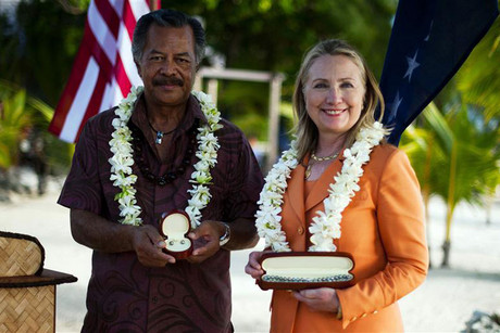 US Secretary of State Hillary Clinton poses with gifts from Cook Islands' PM Puna during a sustainable development and conservation event in Rarotonga (Reuters)