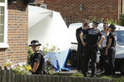 French and British police talk at the Claygate home of Saad al-Hilli (Reuters)