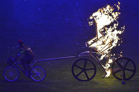 A performer cycles in the Olympic Stadium during the closing ceremony of the London 2012 Paralympic Games  (Reuters)