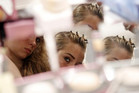 A model checks her look in a mirror backstage before the Tracy Reese collection (Reuters)