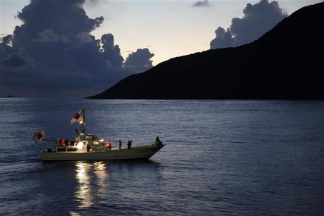 A fishing boat sails around a group of disputed islands known as Senkaku in Japan and Diaoyu in China in the East China Sea (Reuters)