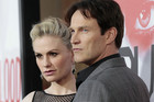 Cast members Anna Paquin (L) and her husband Stephen Moyer pose at the premiere for the 5th season of the HBO television series &quot;True Blood&quot; at the Cinerama Dome in Los Angeles (Reuters/Mario Anzuoni)