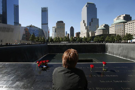 A woman reflects at the North Pool of the 9/11 Memorial on the 11th anniversary of the 9/11 attacks (Reuters)
