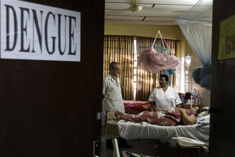 A patient lies on a bed in a ward reserved for people suffering from dengue fever in a hospital at Barrio Obrero district in Paraguay (Reuters)