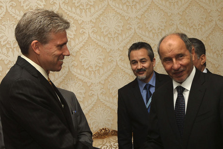 Christopher Stevens (left) with the Libyan National Transitional Council chairman in June (Reuters)