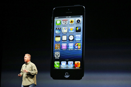 Phil Schiller, senior vice president of worldwide marketing at Apple, shows off the new iPhone 5 (Reuters)