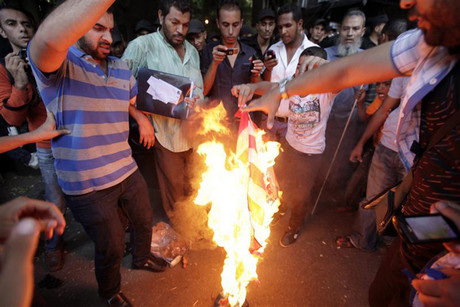 Egyptian protesters burn the US flag during a demonstration in Cairo