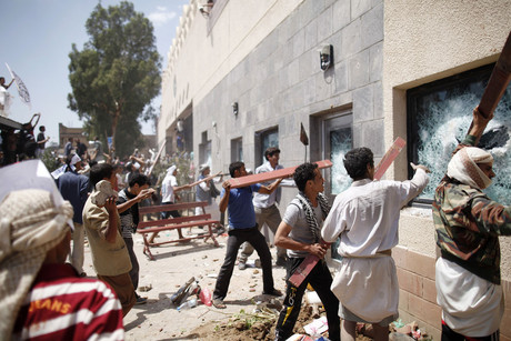 Protesters break the windows of the US embassy in Sanaa (Reuters)