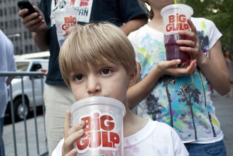 Child takes a sip of a 'Big Gulp' while protesting the proposed ban