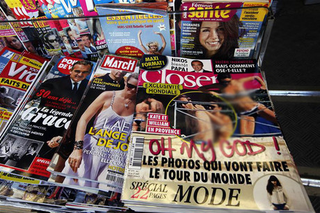 Copies of French magazine Closer showing pictures of Catherine, Duchess of Cambridge, and Britain's Prince William are displayed in a newspaper kiosk in Nice (Reuters)