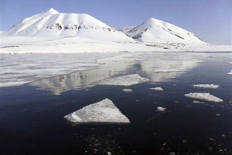 Snow-covered mountains look over the Isfjord in Svalbard, the remotest and wildest place in the Arctic with regularly scheduled flights (Reuters)