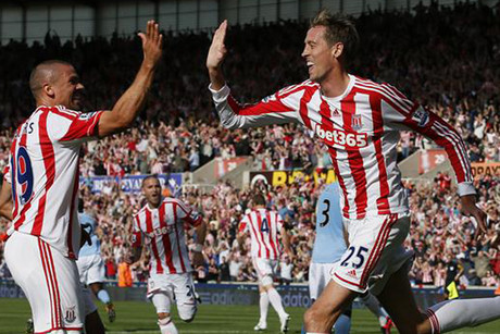 Stoke City's Peter Crouch, right, celebrates with teammate Jonathan Walters (Reuters)