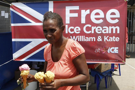 A customer walks past a billboard offering free ice cream to anyone named William or Kate at Frangipani ice cream shop in Honiara (Reuters)