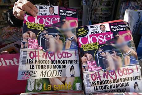 Copies of the magazine which published the photos (Reuters)