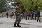 A member of Afghan security forces keeps watch at the site of suicide bomb attack in Kabul (Reuters)