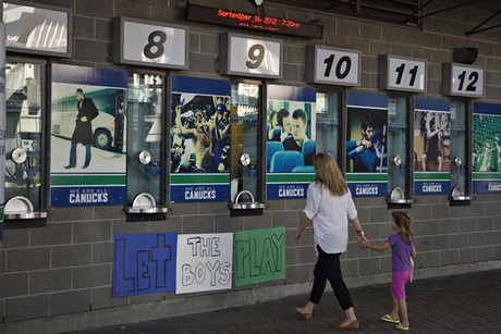 A sign in support of the players sits outside the box office of the National Hockey League's Vancouver Canucks in Vancouver (Reuters)