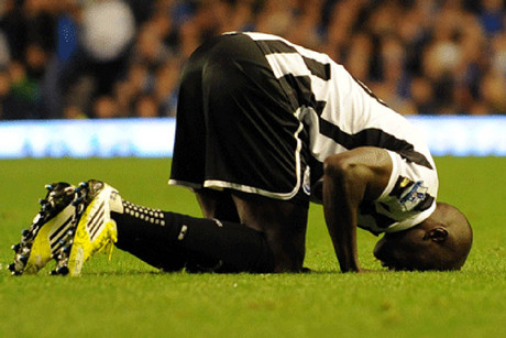 Newcastle's Demba Ba gets the first of his second goal and kisses the ground (Reuters)