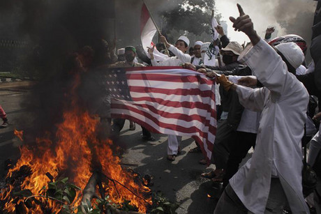 Indonesian Muslim protesters burn a mock U.S. flag during a protest in Jakarta (Reuters)