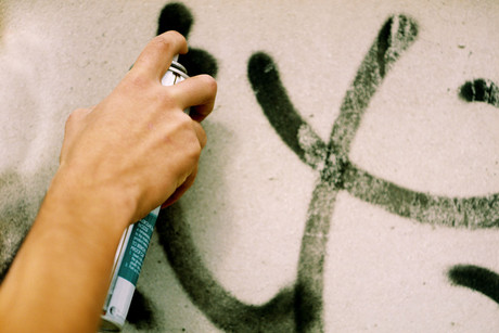 Under the new law the council will be able to remove graffiti from buildings (file)