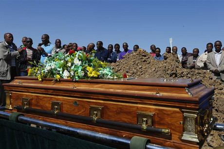 Mourners attend funeral of Ntsenyeho one of 34 striking platinum mineworkers shot dead at Lonmin's Marikana mine (Reuters)
