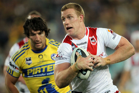 Ben Creagh races away from Nathan Hindmarsh (AAP)