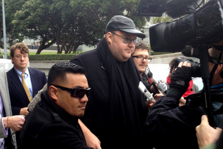 Kim Dotcom arrived at the Court of Appeal with his wife and a security contingent (photo: Rhiannon McConnell / 3 News)