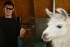 James Holmes gestures next to a llama in this photograph submitted with his application to graduate school at the University of Illinois (Reuters)