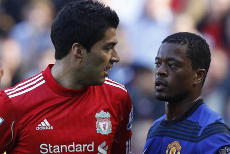 Luis Suarez and Patrice Evra meet for the first time since an angry pre-match clash last season (Reuters)