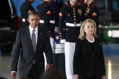 US President Obama and Secretary of State Clinton participate in a transfer ceremony of the remains of US Ambassador to Libya, Chris Stevens and three other Americans killed in Benghazi, at Andrews Air Force Base near Washington (Reuters)