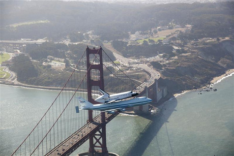 Space shuttle Endeavour and 747 carrier aircraft soar over Golden Gate Bridge during final portion of its tour of California (Reuters)