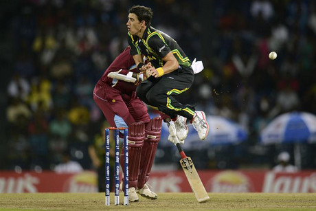 Australia's Starc leaps to avoid a throw (Reuters)
