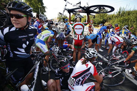 Cyclists pick up the pieces after a massive crash (Reuters)